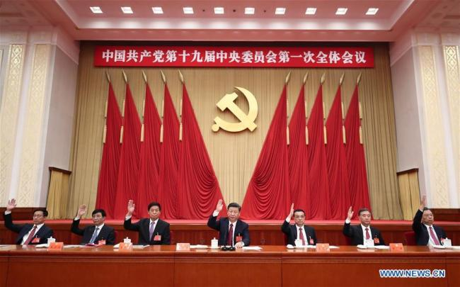 Xi Jinping (C), Li Keqiang (3rd R), Li Zhanshu (3rd L), Wang Yang (2nd R), Wang Huning (2nd L), Zhao Leji (1st R) and Han Zheng (1st L) attend the first plenary session of the 19th Communist Party of China (CPC) Central Committee at the Great Hall of the People in Beijing, capital of China, Oct. 25, 2017. [Photo: Xinhua/Ju Peng]
