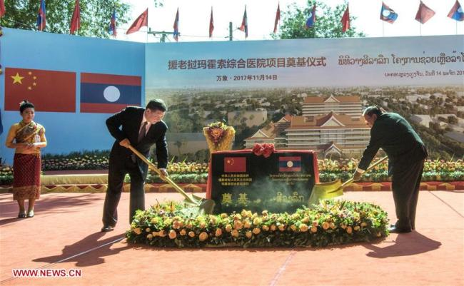 Chinese President Xi Jinping and his Laotian counterpart Bounnhang Vorachit attend the foundation stone laying ceremony for a China-built hospital in Vientiane on November 14, 2017. The two leaders also called for more China-Laos cooperation in public welfare. [Photo: Xinhua]