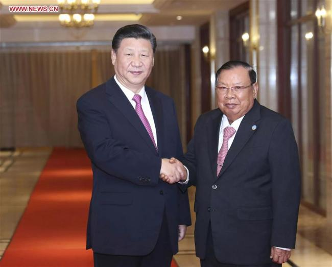 Chinese President Xi Jinping (L), also general secretary of the Communist Party of China Central Committee, meets again with Lao President Bounnhang Vorachit, also general secretary of the Lao People's Revolutionary Party Central Committee, in Vientiane, Laos, Nov. 14, 2017. [Photo: Xinhua]