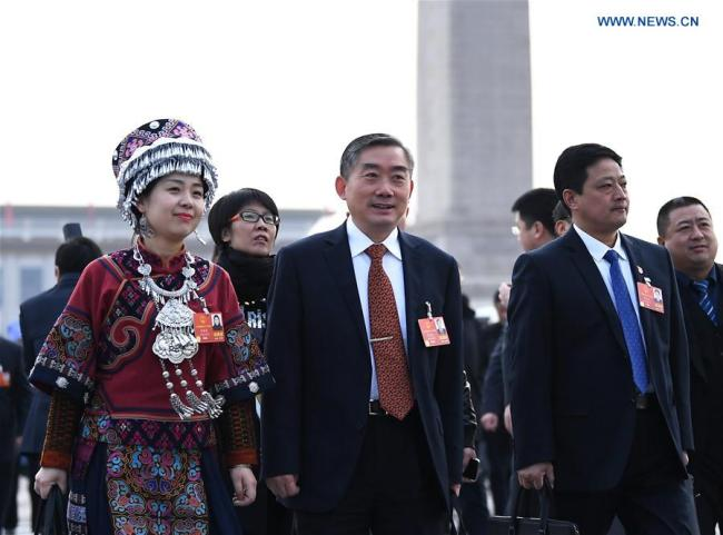 Deputies to the 13th National People's Congress (NPC) walk to the Great Hall of the People for the opening meeting of the first session of the 13th NPC in Beijing, capital of China, March 5, 2018. (Xinhua)
