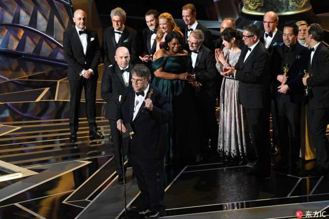 Guillermo del Toro, director of The Shape of Water, accepts the Oscar for best motion picture of the year during the 90th Academy Awards, Mar. 4, 2018. [Photo: IC]