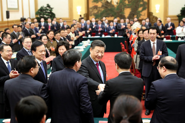 Chinese President Xi Jinping, also general secretary of the Communist Party of China (CPC) Central Committee and chairman of the Central Military Commission, joins a panel discussion with deputies from Chongqing Municipality at the first session of the 13th National People's Congress in Beijing on Saturday, March 10, 2018. [Photo: Xinhua]