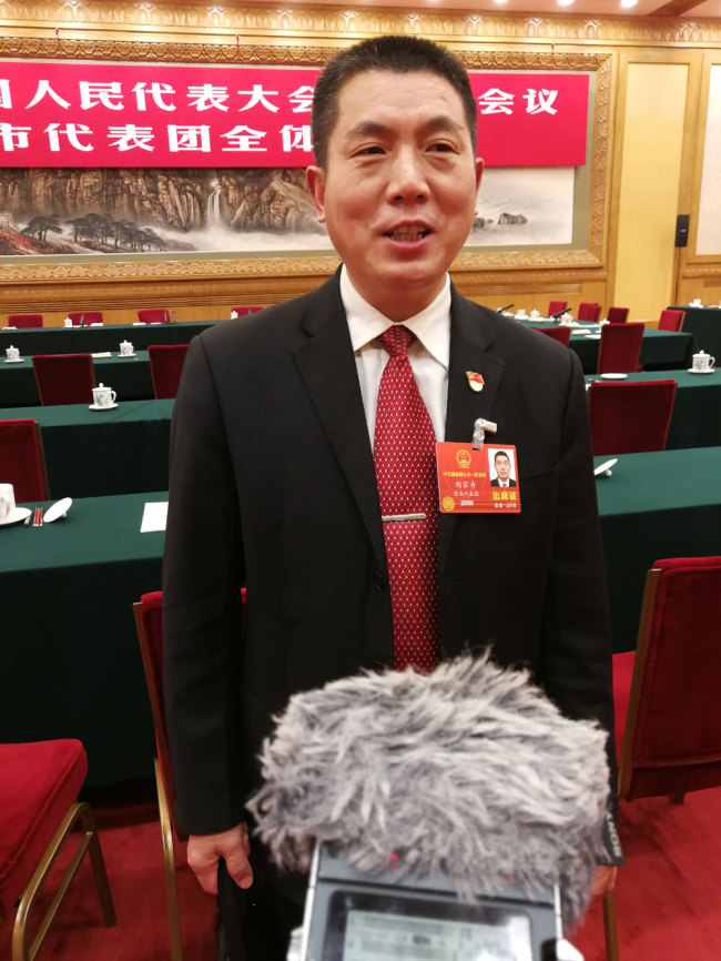 Liu Jiaqi, a deputy from the municipality of Chongqing for the 13th National People's Congress (NPC) is interviewed by journalists on March 10, 2018. [Photo: China Plus]
