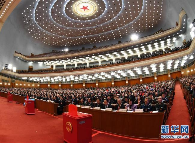 The third plenary meeting of the first session of the 13th National People's Congress opens at the Great Hall of the People in Beijing on March 11, 2018. [Photo: Xinhua]