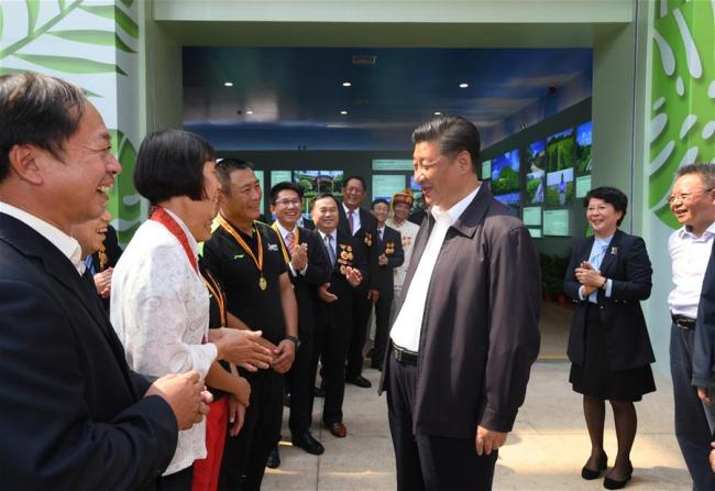Chinese President Xi Jinping, also general secretary of the Communist Party of China Central Committee and chairman of the Central Military Commission, talks with model workers and representatives of different occupations at a plaza of the Hainan Museum in Haikou, south China's Hainan Province, April 13, 2018. Xi made an inspection tour in Hainan from Wednesday to Friday. [Photo: Xinhua]