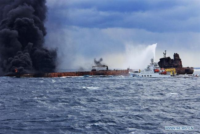 Rescuers spray foam to extinguish flames on the stricken oil tanker SANCHI off the coast of east China's Shanghai, Jan. 12, 2018. Shanghai Maritime Safety Administration said there is still a large fire on the Panama-registered oil tanker SANCHI. It is likely to explode and sink, the administration said at a press conference on Friday. [Photo: Xinhua]