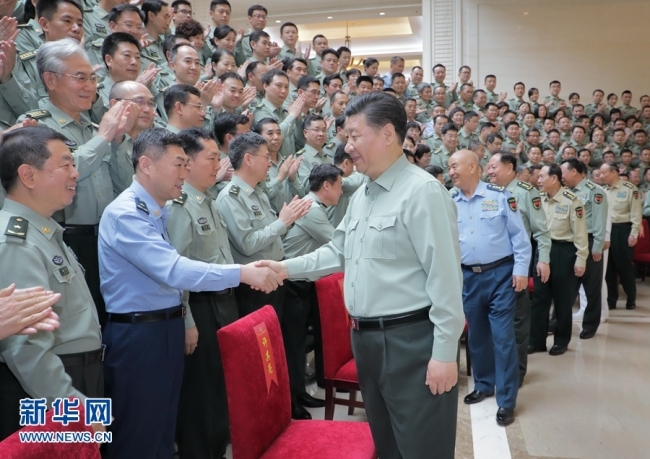 Chinese President Xi Jinping inspects the People's Liberation Army Academy of Military Science in Beijing on May 16, 2018. [Photo: Xinhua]