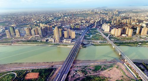 "Jinjiang City in Fujian Province used to be known only as ""China's shoes and clothing capital"". Young entrepreneurs in the city are on the hunt for innovations to meet the challenges the affluent coastal city is facing.[Photo:mnw]"