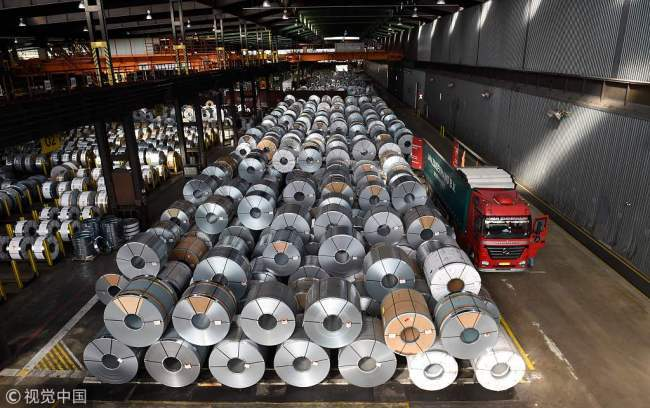 In this file photo taken on March 17, 2015, coils are stored for delivery at the production site of German steel technology group Salzgitter AG in Salzgitter. [File Photo: VCG]