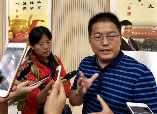 Li Jinzhu, the leading official in Xiaogang Village, talks about the future development of the village, which was the birthplace of China's agriculture reforms. [Photo: China Plus/ Liao Liang]