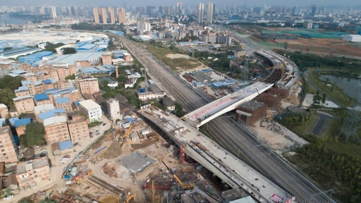 Massive flyover swiveled into place during high-speed rail construction
