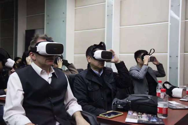 "Audiences wearing virtual reality glasses watch the Australian-Chinese feature film ""The Calling"" in Beijing on Friday, November 2, 2018.[Photo provided to China Plus]"
