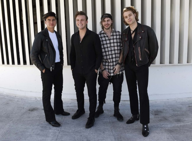 """This Oct. 18, 2018 photo shows members of the band 5 Seconds of Summer, from left, Calum Hood, Ashton Irwin, Michael Clifford and Luke Hemmings posing at Capitol Records in Los Angeles to promote their third album """"Youngblood."""" [Photo: AP]"""