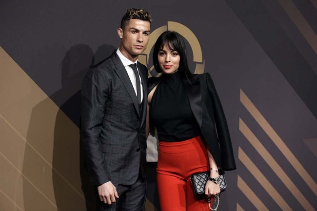 Real Madrid player Cristiano Ronaldo and his girlfriend Georgina Rodriguez pose for photos as they arrive for the Portuguese soccer federation awards ceremony Monday, March 19, 2018, in Lisbon. [Photo: AP]