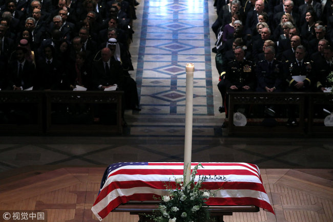 The Casket stands at the alter during the state funeral for former U.S. President George H.W. Bush at the Washington National Cathedral in Washington, U.S., December 5, 2018. [Photo: VCG]