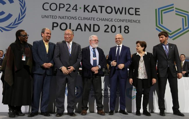 Heads of the delegations react at the end of the final session of the COP24 summit on climate change in Katowice, Poland, Saturday, Dec. 15, 2018. [Photo: AP/Czarek Sokolowski]
