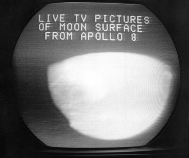 This Dec. 24, 1968, file photo shows a television screen with a view of the moon transmitted by the Apollo 8 astronauts as it orbited. The curves within the television image are caused by the edges of the spacecraft windows and the lunar horizon. [File photo: AP/Anthony Camerano]