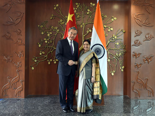 Chinese State Councilor and Foreign Minister Wang Yi shakes hands with his Indian counterpart Sushma Swaraj on Friday. [Photo: fmprc.gov.cn]