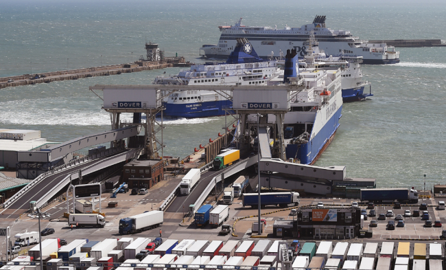 Lorries disembark from ferries in Dover, south east of London, Britain, August 4, 2015. The British government has chartered ferries to deal with the possibility of an unregulated exit from the European Union. [File photo: IC/EPA/Andy Rain]