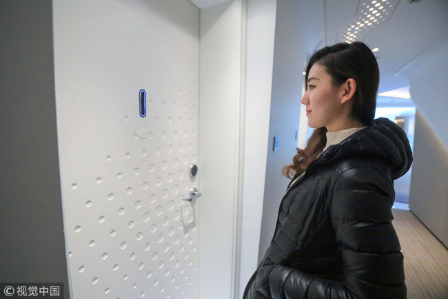 "A guest scans her face to enter her room at Alibaba's AI-driven "" hotel of the future"" in Hangzhou, Zhejiang Province on December 17, 2018. [File photo: VCG]"