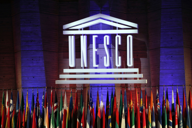 The logo of the United Nations Educational, Scientific and Cultural Organization (UNESCO) is seen during the 39th session of the General Conference at the UNESCO headquarters in Paris, Nov. 4, 2017. [Photo: AP/Christophe Ena]