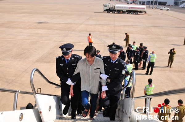 A telecom and Internet fraud suspect is brought back from Laos to central China's Henan Province on Friday, January 11, 2019. [Photo: cri.cn]