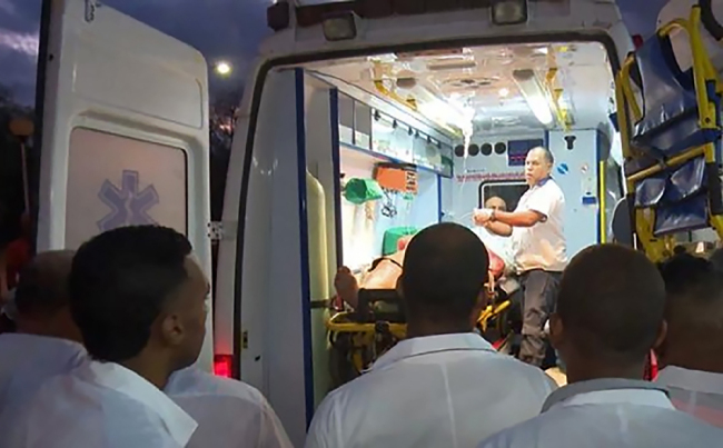 Handout picture released by Cuban official website www.cubadebate.cu showing an ambulance arriving with a wounded person at the provincial hospital of Guantanamo, eastern Cuba, on January 10, 2019 after a bus overturned while driving on the road linking the city of Baracoa, near the island's eastern tip, to the capital Havana. [Photo: www.cubadebate.cu / AFP]