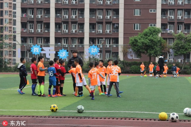 Elementary student take football class at a school in central China's Chongqing Musicality, January 1, 2019. [Photo: IC]