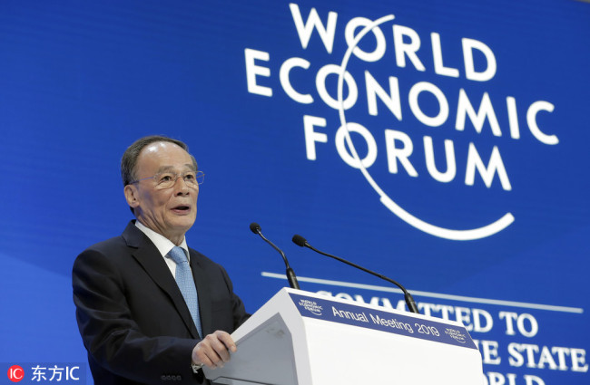Chinese Vice President Wang Qishan addresses the annual meeting of the World Economic Forum in Davos, Switzerland on Wednesday, January 23, 2019. [Photo: IC]