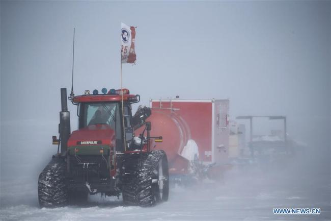 The Kunlun team and the Taishan team of China's 35th Antarctic expedition move amid a blizzard in Antarctica, Feb. 3, 2019. The Kunlun team and the Taishan team of China's 35th Antarctic expedition left the Taishan Station for Zhongshan Station, which is some 520 kilometers away. They are expected to reach the destination on Feb. 8. [Photo: Xinhua/Liu Shiping]
