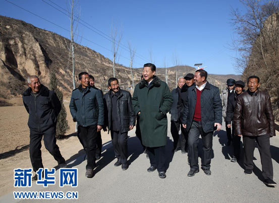 Xi Jinping visits Liangjiahe Village ahead of the Spring Festival in 2015. [Photo: Xinhua]