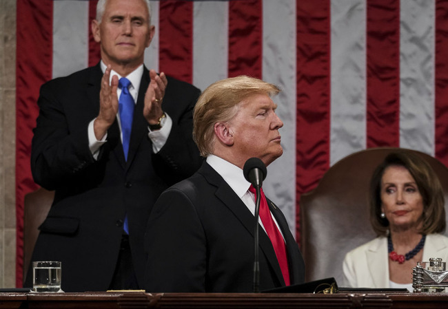 President Donald Trump gives his State of the Union address to a joint session of Congress, Tuesday, Feb. 5, 2019 at the Capitol in Washington, as Vice President Mike Pence, left, and House Speaker Nancy Pelosi look on. [Photo: AP]