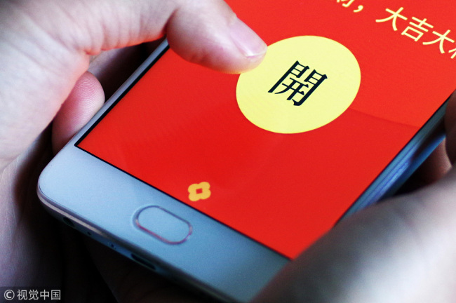 Paper red envelop of lucky money are being replaced by electric money transfers via smartphones. [Photo: VCG]
