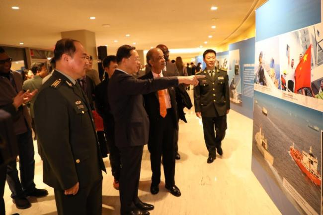 China's permanent representative to the UN Ma Zhaoxu, Under-Secretary-General for Field Support Atul Khare, and other guests at the China peacekeeping exhibition in the United Nations, Feb. 11, 2019. [Photo: China Plus/Qian Shanming]