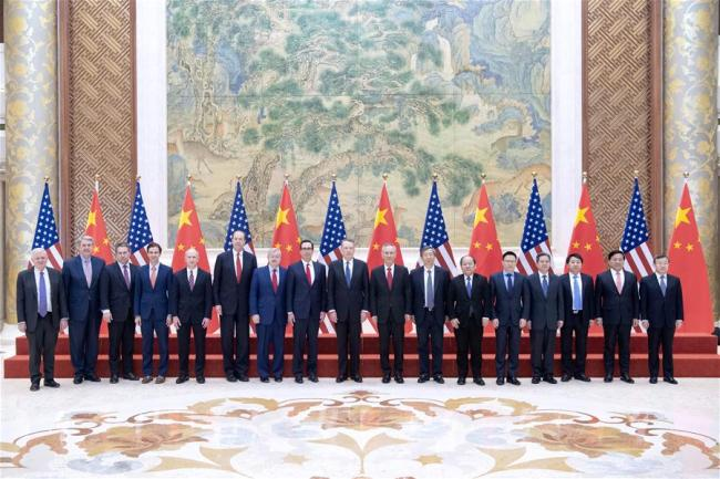 Delegates to the China-U.S. high-level economic and trade consultations pose for a group photo in Beijing, Feb. 15, 2019.  [Photo: Xinhua]