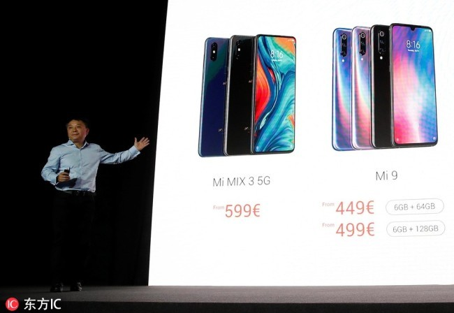 Senior Vice President of Strategic Cooperation at Xiaomi, Xiang Wang, speaks during the presentation of the new Xiaomi Mi 9 and the new Xiaomi Mi Mix 3 5G in an event held on the eve of the Mobile World Congress 2019 (MWC19), in Barcelona, Spain, February 24, 2019. [Photo: IC]