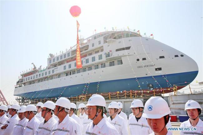 Photo taken on March 12, 2019 shows the launching ceremony of the first China-made cruise ship for polar expeditions, held in Haimen, east China's Jiangsu Province. The first China-made cruise ship for polar expeditions tested the water on Tuesday in Haimen, east China's Jiangsu Province. Hu Xianfu, general manager of the shipbuilder China Merchants Group, said the 104.4-meters long vessel is 18.4 meters at the beam. It can operate at a speed of 15.5 knots. With a gross tonnage of 7,400 tonnes, it can accommodate 255 people on board. [Photo: Xinhua/Xu Congjun]