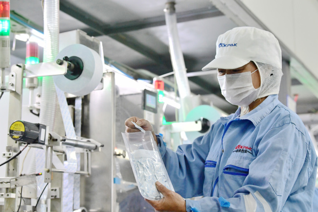 A staff member works at a factory producing food preservatives in Hai'an, Jiangsu Province on July 1, 2018. [File photo: IC]