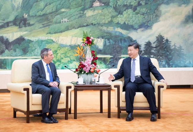 Chinese President Xi Jinping (R) meets with president of Harvard University Lawrence Bacow at the Great Hall of the People in Beijing, capital of China, March 20, 2019. [Photo: Xinhua]