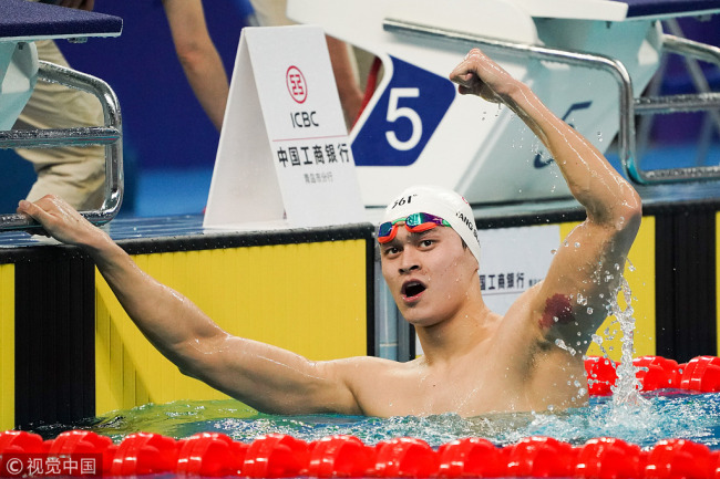 Sun Yang celebrates after winning the 1,500m freestyle of the Chinese Swimming National Championships held in Qingdao, Shandong Province, on Sunday, March 31, 2019. [Photo: VCG]