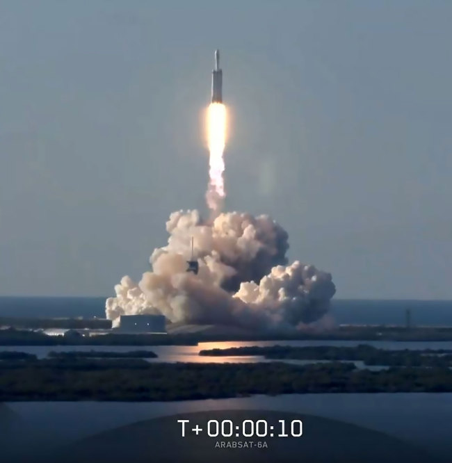 This still image from video courtesy of SpaceX shows the SpaceX Falcon Heavy Rocket lifting off from Kennedy Space Center in Florida, April 11, 2019. [Photo: AFP/ SPACEX]