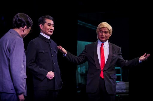 "Actor Loong Koon-tin (R), dressed as US President Donald Trump, performs on stage during a rehearsal of a Cantonese opera called ""Trump on Show"", in Hong Kong on April 11, 2019. [Photo:AFP]"