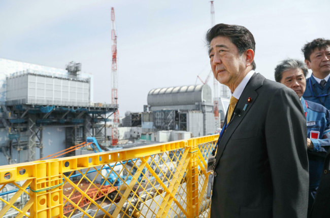 Japanese Prime Minister Shinzo Abe visits Fukushima Dai-ichi nuclear power plant in Okuma, Fukushima prefecture, Japan, Sunday, April 14, 2019, to inspect the reconstruction effort following the tsunami, quake and nuclear accident in 2011. [Photo: Kyodo News via AP]