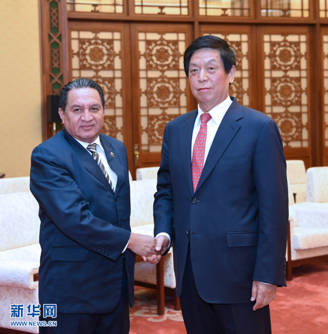 Li Zhanshu, chairman of the National People's Congress (NPC) Standing Committee, meets with Jose Serafin Orantes, the first vice president of the Legislative Assembly of El Salvador, in Beijing on April 15, 2019. [Photo: Xinhua]