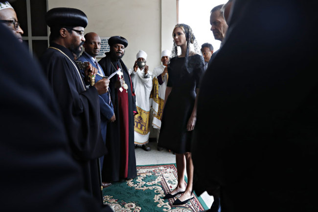 White House senior adviser Ivanka Trump, center, is greeted as she arrives for a ceremony at Holy Trinity Cathedral honoring the victims of the Ethiopian Airlines crash, Monday, April 15, 2019, in Addis Ababa, Ethiopia. [Photo: AP/Jacquelyn Martin]