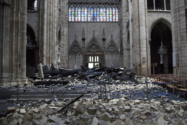 A general view shows debris inside the Notre-Dame-de Paris Cathedral in Paris on April 16, 2019, a day after a fire that devastated the building in the center of the French capital. [Photo: AFP/Amaury Blin]