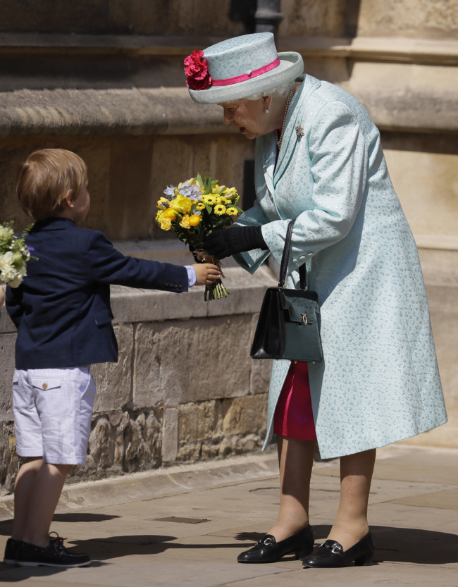Britain's Queen Elizabeth II is presented with flowers as she leaves after attending the Easter Mattins Service at St. George's Chapel, at Windsor Castle in England Sunday, April 21, 2019. [Photo: AP]