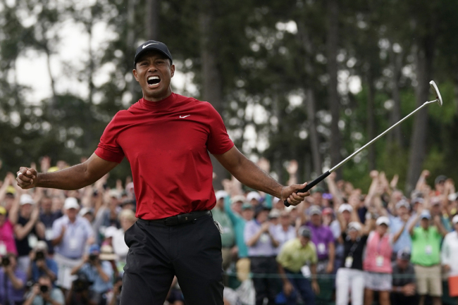 Tiger Woods reacts as he wins the Masters golf tournament Sunday, April 14, 2019, in Augusta, Ga. [Photo: AP]
