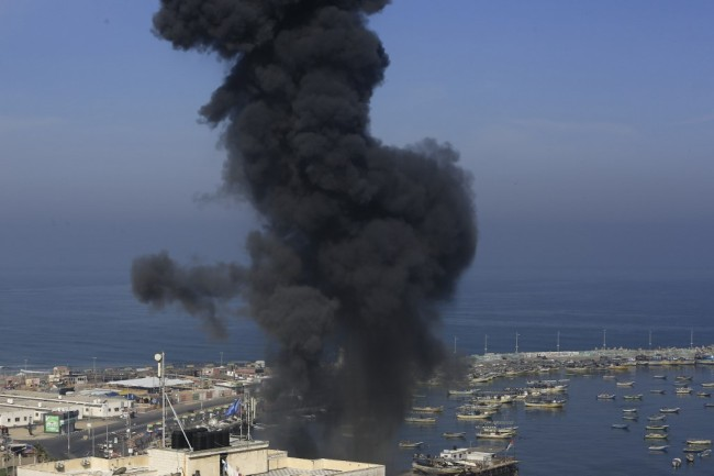 Smoke billows in the area overlooking Gaza City's main port during an Israeli airstrike on the Hamas-run Palestinian enclave on May 5, 2019. [Photo: AFP/Mohammed Abed]