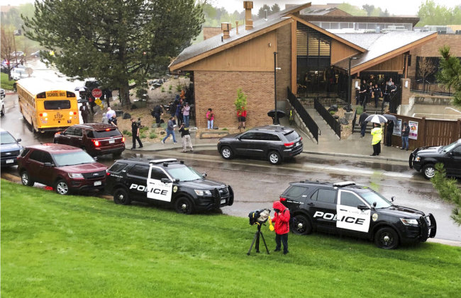 Police and others are seen outside a recreation center where students are reunited with their parents, in the Denver suburb of Highlands Ranch, Colo., after a shooting at STEM School Highlands Ranch Tuesday, May 7, 2019. [Photo: AP]
